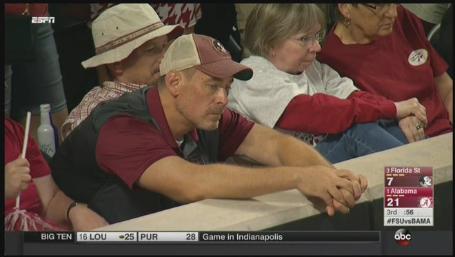 A sad djected Florida State fan is caught on camera during the Florida State versus Alabama game.