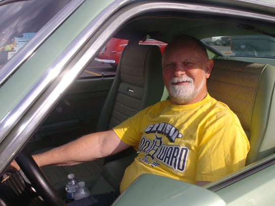 Mick Stolarczyk of Livonia enjoys sitting behind the wheel of his 1971 Comet GT.