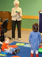 June Bates, Bath Rotarian, reads to children at the Dormann Library during its weekly Story Time as part of the club's participation in Rotary Literacy Month.