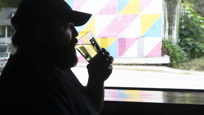 Production Director and cider maker Gregory Hill tastes fresh cider at Urban Orchard Cider Co. at 210 Haywood St. on Wednesday.