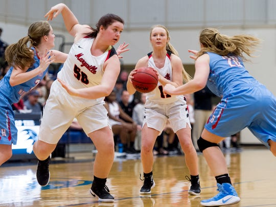 Maryville's Courtney Carruthers (11) looks for a shot as Jazz Atkins (50) blocks and Heritage's Emma Harig (20) and Kirsten Potenza (2) defend during the District 4-AAA girls basketball tournament quarterfinals game between Maryville and Heritage at Hardin Valley Academy in Knoxville, Tennessee on Wednesday, February 15, 2017.