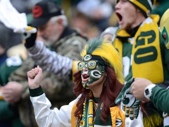 Packers fans cheer in the first quarter of the divisional