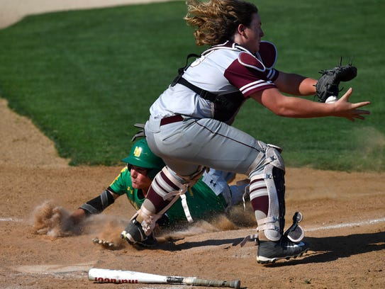 New Deal's Tanner Seeley slides into home past Hawley catcher Kolter Willeford during Friday's second game of the Region I-2A final series at Snyder's Moffett Field. New Deal took the lead on the play, finishing the game and winning the series with 4-3 as the final score.