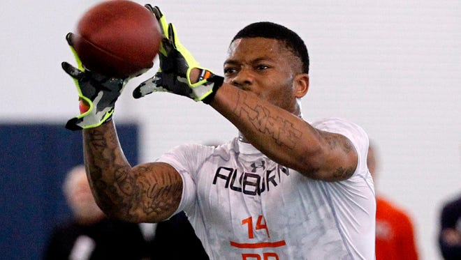 Nick Marshall catches a pass at Pro Day Tuesday, March 3, 2015, in Auburn, Ala. The event is to showcase players for the upcoming NFL football draft.