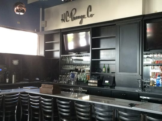 The downtown Creamery offers a nod to downtown Green Bay's past with  the H.C. Prange Co. sign above the bar.
