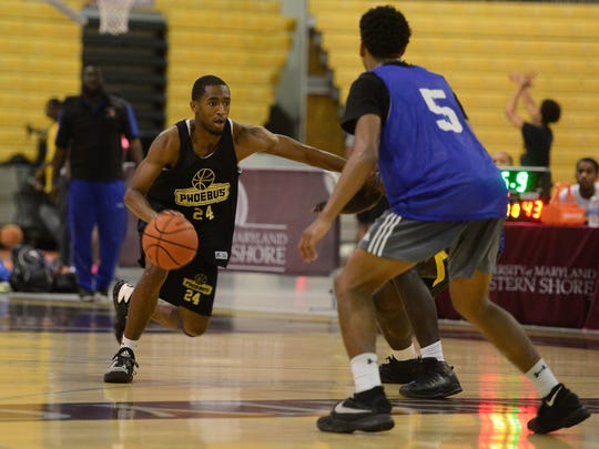 Stephen Decatur (blue) played against Phoebus (black) during The Maryland Eastern Shore Team Camp held at the William P. Hytche Athletic Center in Princess Anne, MD. on Friday, June 23, 2017.