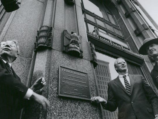 In 1989, Detroit's Fisher Building became a National Historic Landmark.  Local businessmen Edgar Parks, left, Mike Irwin, center, attended the plaque presentation along with Ivan Mills, right.
