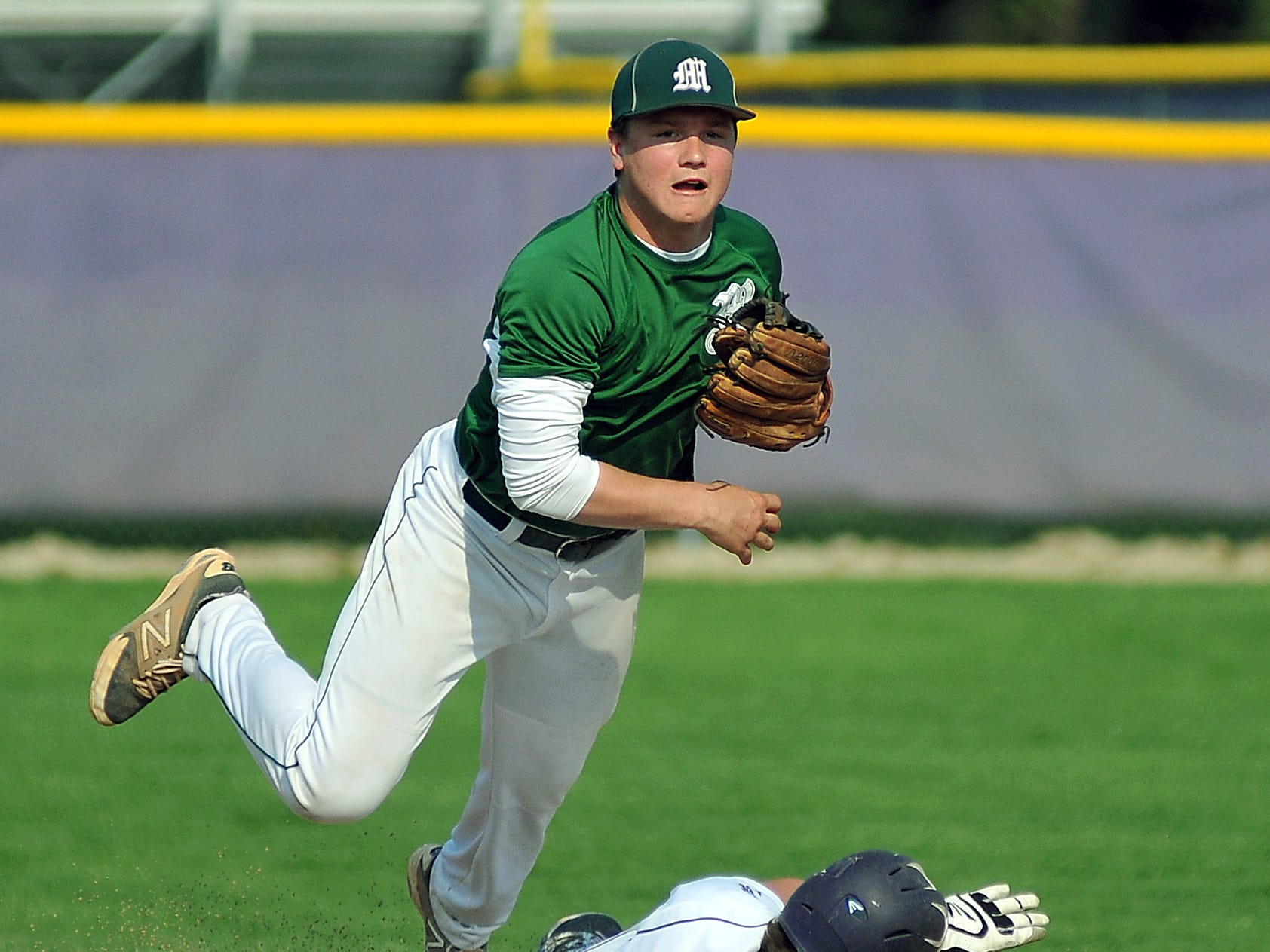 Madison's Alec Keen turns a double play during their game Thursday against Lexington.