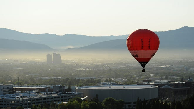 Hot air balloons fill the air during the opening day of the Great Reno Balloon Race at San Rafael Regional Park in Reno on Sept. 10, 2015.