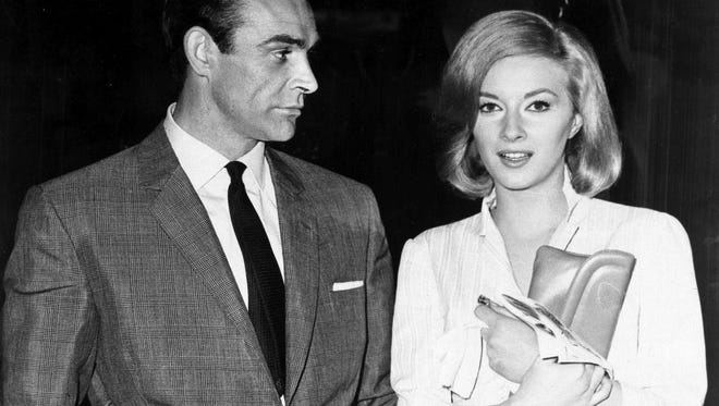 In this Apr. 25, 1963 file photo, Sean Connery and Italian actress Daniela Bianchi are seen in Istanbul, Turkey. The pair were in the country filming the second Bond film, 'From Russia with Love.' Connery was playing the British secret agent for the second time in what many critics consider to be one of the best Bond film of all. His suave but menacing Bond remains the standard for many Bond fans.