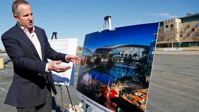 Chris Meany, senior vice president of Hollywood Park Land Company unveils an architectural rendering Jan. 5, 2015, of a proposed NFL stadium at Hollywood Park in Inglewood, Calif.