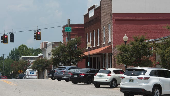 The Milton City Council is weighing whether to allow bars and taverns to operate in residential areas downtown.