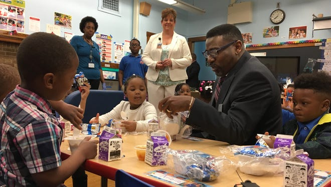Milwaukee Public Schools Interim Superintendent Keith Posley meets with students in a classroom at Benjamin Franklin School.