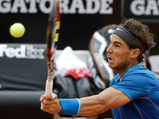 Spain's Rafael Nadal returns the ball to Serbia's Novak Djokovic during their final match at the Italian Open tennis tournament, in Rome, Sunday, May 18, 2014. Novak Djokovic extended his recent dominance over Rafael Nadal by rallying for a 4-6, 6-3, 6-3 victory Sunday to win the Italian Open for the third time. (AP Photo/Andrew Medichini)