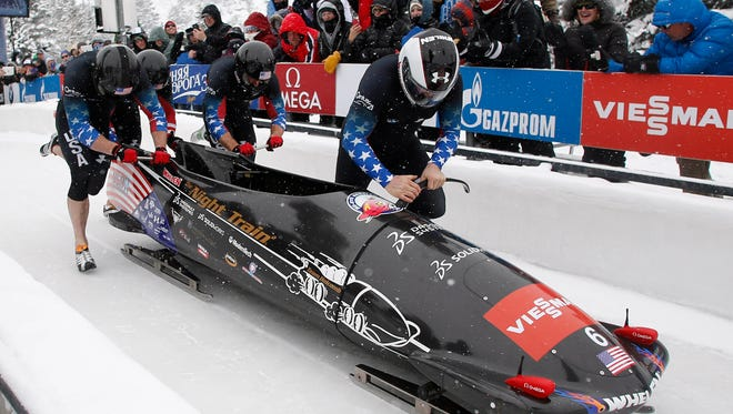 Steven Holcomb pilots the United States four-man team during the IBSF bobsleigh World Cup at Utah Olympic Park.