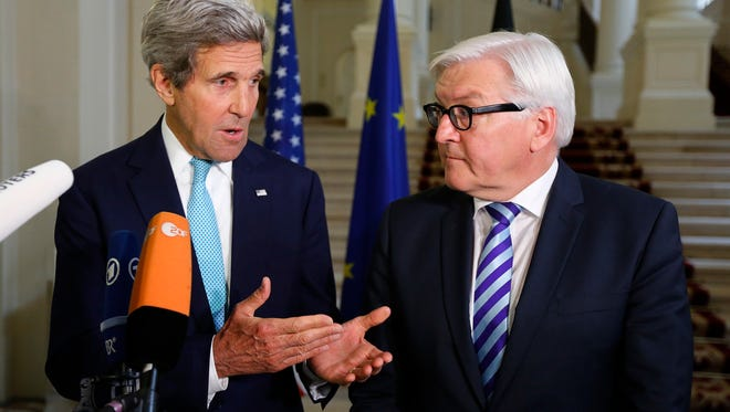 U.S. Secretary of State John Kerry, left, and German Foreign Minister Frank-Walter Steinmeier talk in Vienna on July 13, after discussions between the foreign ministers of the six powers negotiating with Tehran on its nuclear program.