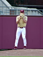 Junior left-hander Tyler Holton focuses in on the ball during first game of the Garnet & Gold scrimmage at Dick Howser Stadium.