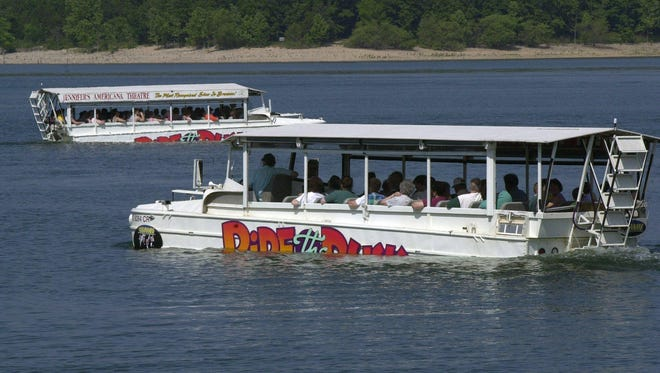 In this 2000 photo, amphibious tour buses, called duck boats, cruise Table Rock Lake during Ride The Duck tours.