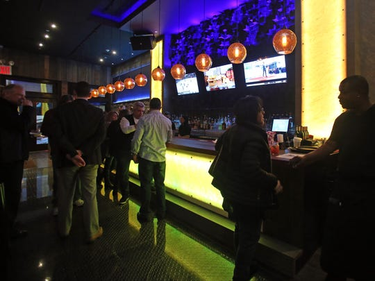 A view of the bar at Holy Crab restaurant in White Plains.