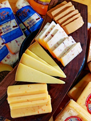 Cheese from Wisconsin Cheese Mart includes from bottom to top, Mango Fire, Pleasant Ridge, Bacon Gouda and Gjetost Cheese.