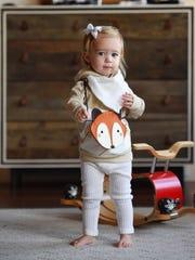 Gold arrow hoodie, knit winter white leggings, bandana