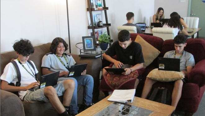 """Some students in Summit High School's """"Cafe Class"""" say the relaxed seating helps them focus on their work."""