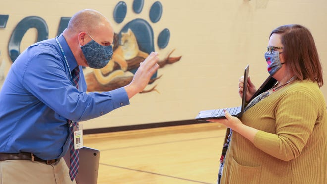 Principal Mark Page waves to Atkinson staff and students who joined in virtually on the celebration, thanks to behind-the-scenes work from Amanda Childers, Small Schools Administrator.
