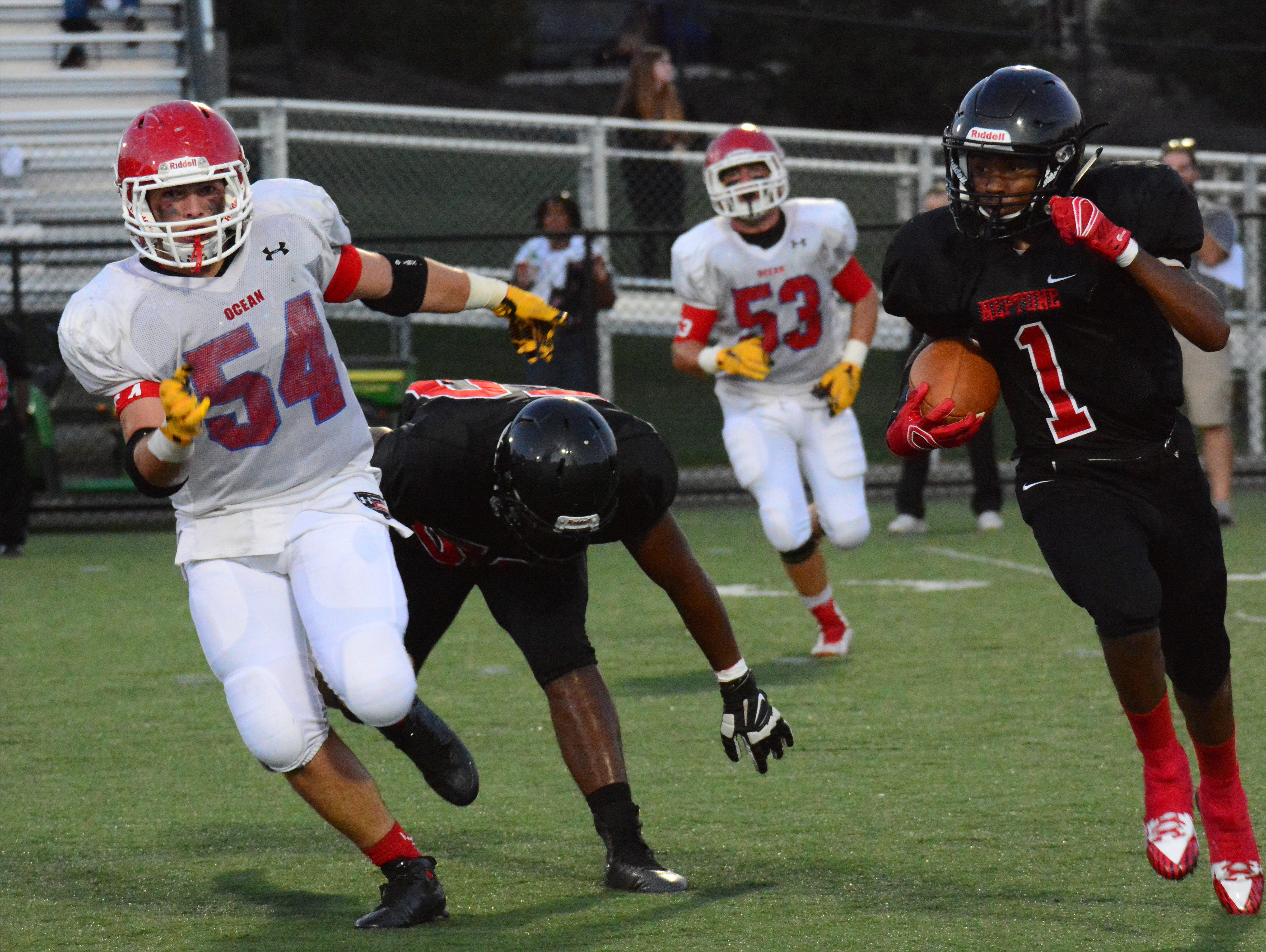 (SPORTS) 09/11/15 Neptune, NJ Neptune's Isaiha Calhoun (1) is persued by Ocean's Anthony Tedesco (54) during first half action at Neptune. Frank Galipo/Special to the Press ASB 0912 Neptune Football H
