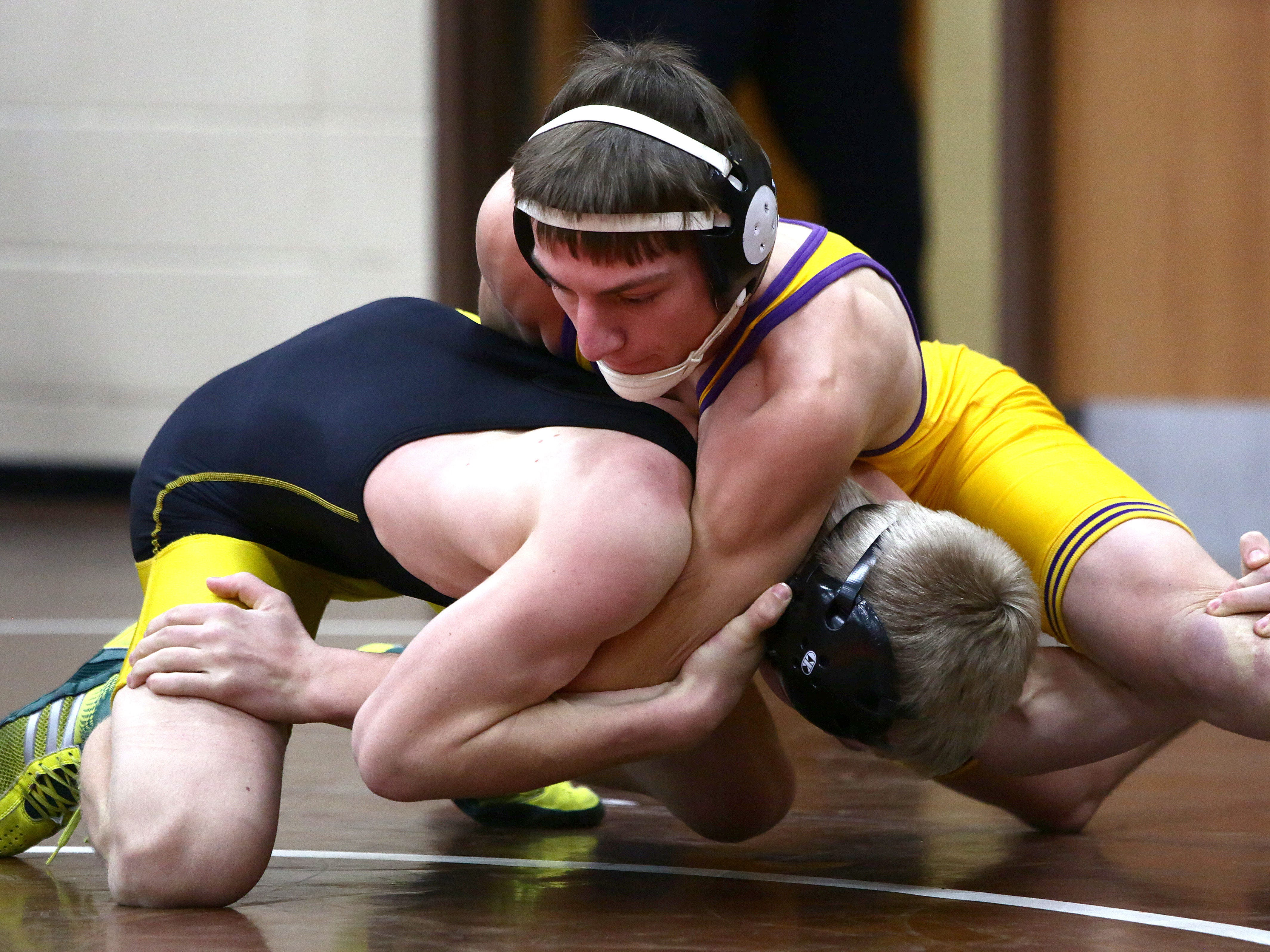 Lexington's Max Baker tops Northmor's previously unbeaten Conan Becker 11-0 in Friday's first round of the J.C. Gorman Invitational.