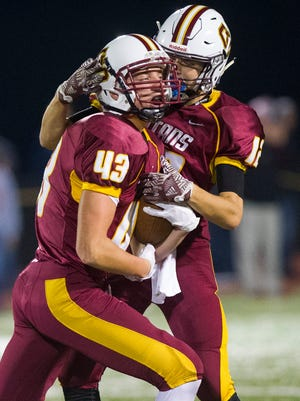 Gibson Southern's Wes Obermeier (43) celebrates with teammate Gibson Southern's Dawson Witte (12) during their game against Southridge at Jewell Memorial Field in Fort Branch, Friday, Oct. 14, 2016. Gibson Southern beat Southridge 38-35.