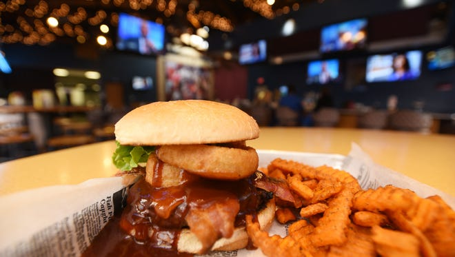 The BBQ burger at Mac's Sports Grill at EagleSticks Golf Club features a generous coating of barbecue sauce.