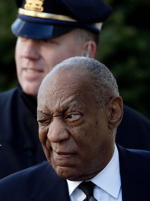 Bill Cosby winks at onlookers as he arrives for a pretrial hearing back in March.
