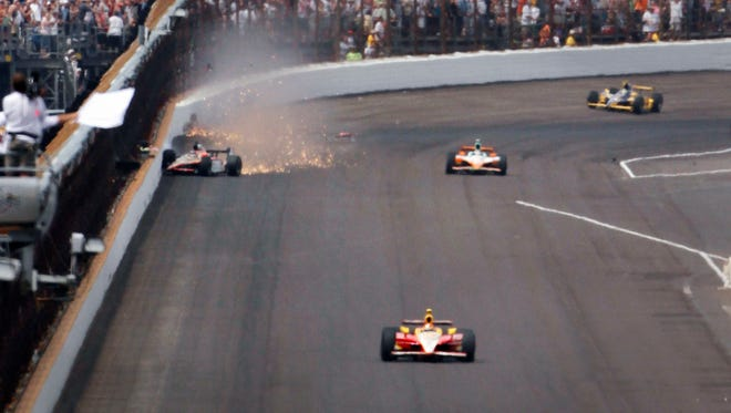 Leading the 100th anniversary Indianapolis 500 on the final lap, rookie J.R. Hildebrand, left, hits the wall coming out of Turn 4 at the Indianapolis Motor Speedway on Sunday, May 29, 2011. Eventual winner Dan Wheldon, enters the frame at right on his way to victory. This was the 95th running of the race.