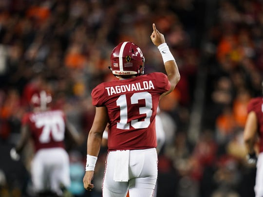 Jan 7, 2019; Santa Clara, CA, USA; Alabama Crimson Tide quarterback Tua Tagovailoa (13) reacts during the first quarter in the 2019 College Football Playoff Championship game against the Clemson Tigers at Levi's Stadium. Mandatory Credit: Kyle Terada-USA TODAY Sports