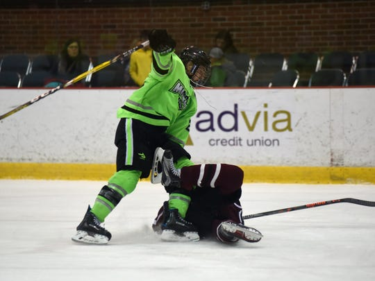 Chiacgo Missions' Wyatt Schingoethedelivers a hit to Shattuck St. Marys Aaron Eberhardt after driving to the net  Sunday, Jan. 16, during the Bantam AAA Silver Stick Final Championship at McMorran Arena in Port Huron.