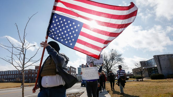 Protesters march down Boonville Avenue to voice their opposition to Donald Trump on Friday, Jan. 20, 2017.