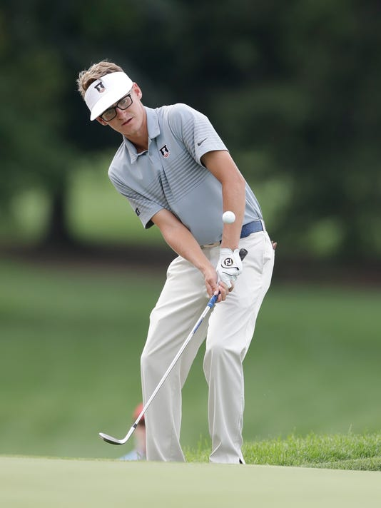 Dylan Meyer hits onto the 10th green during a quarterfinal round of the U.S. Amateur golf tournament at Oakland Hills Country Club, Friday, Aug. 19, 2016, in Bloomfield Township, Mich. (AP Photo/Carlos Osorio)