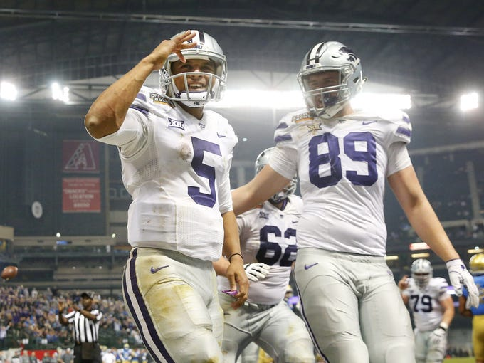 Kansas State quarterback Alex Delton (5) celebrates