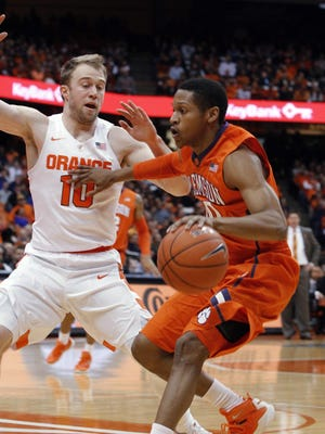 Clemson's Jordan Roper, right, drives to the basket against Syracuse's Trevor Cooney during the first half of Tuesday's game. Michael Gbinije led Syracuse (10-6) with 22 points, while freshman Malachi Richardson scored a career-high 21.