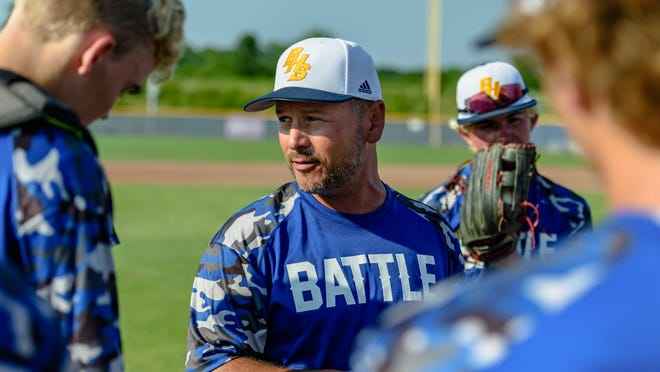 Battle head baseball coach Doug Boyer speaks with his team before its final summer game last Tuesday at Atkins Sports Complex.