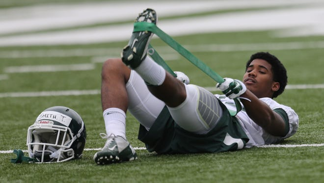 Michigan State cornerback Tyson Smith goes through drills during MSU's first practice of the fall Aug. 8, 2015, in East Lansing.