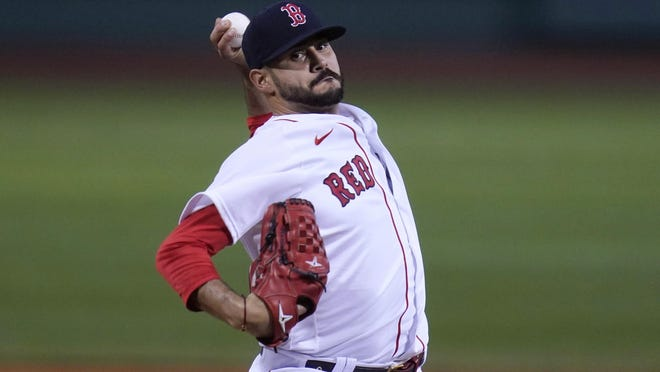 Red Sox starting pitcher Martin Perez winds up during the first inning of Thursday's game against the Toronto Blue Jays in Boston.