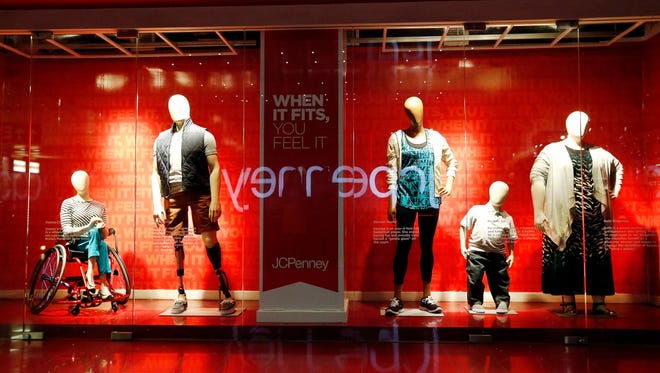 New real size mannequins are displayed in the store windows of its Manhattan Mall location in New York.