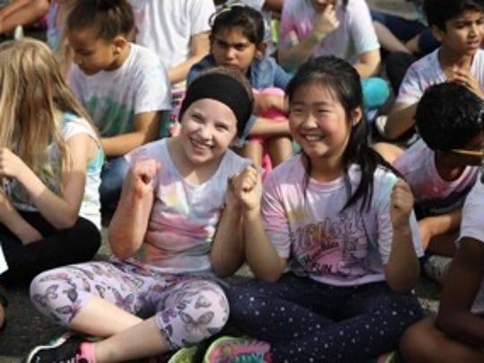 Hillside students Elena Anzivino and Angela Hwang prepare
