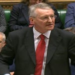 Shadow Foreign Secretary Hilary Benn makes a speech to lawmakers inside the House of Commons in London, during a debate on launching airstrikes against Islamic State extremists inside Syria.