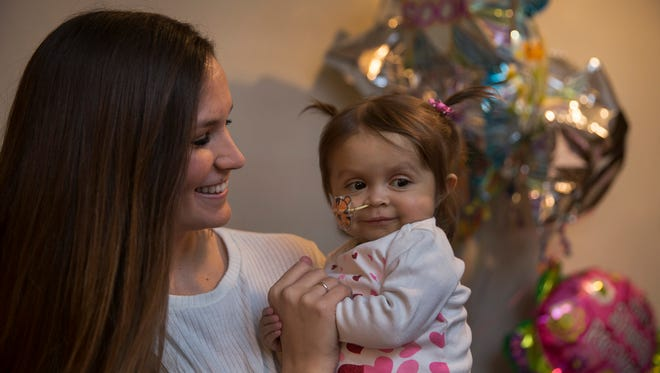 Kiersten Miles, a 22-year-old babysitter from Wall, with Natalia Rosko, a 1 year-old Jackson resident. Miles donated a piece of her liver to save Rosko.