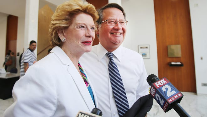 Sen. Debbie Stabenow  and the U.S. Senate candidate Gary Peters speak with the media Aug. 6, 2014, at the Unity breakfast at Wayne State University.