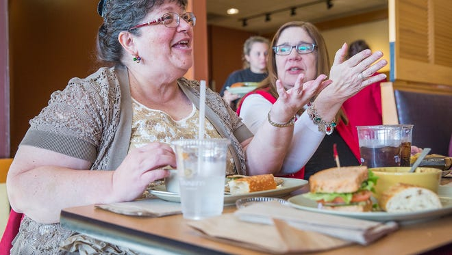 Kristi Eiler joins three friends at Panera on McGalliard Road for an early Christmas gift exchange Sunday afternoon.