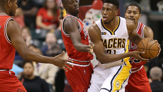 Indiana Pacers forward Thaddeus Young (21) fights off Bulls defenders during second half action against the Chicago Bulls, Banker's Life Fieldhouse, Indianapolis, Thursday, October 6, 2016. The Pacers won, 115-108.