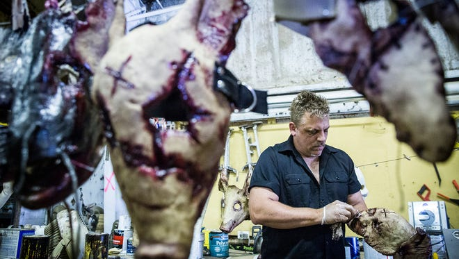 Brian Blair fills Halloween mask orders at Scarevania Thursday afternoon.